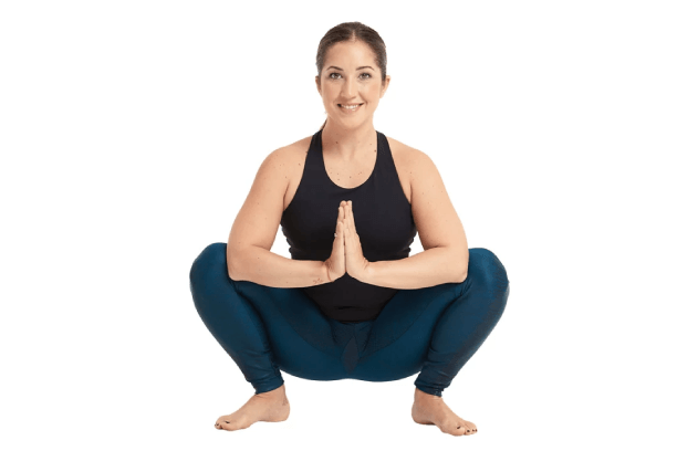 Squat and hold your hands together for Squat Prayer